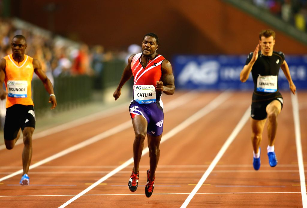 Justin Gatlin (C) from the United States competes during the Men's 200m race at the Memorial Van Damme IAAF Diamond League international athletics meeting in ...