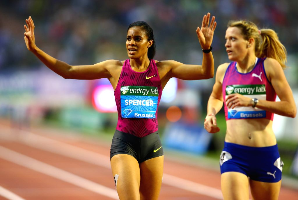 Kaliese Spencer (L) from Jamaica celebrates winning Women's 400m Hurdles race race at the Memorial Van Damme IAAF Diamond League international athletics meeting in