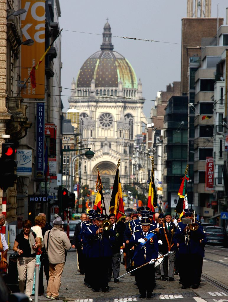 Members of a military band perform during a ceremony held to mark the 70th anniversary of the liberation of Brussels in Brussels, Belgium, Sept. 5, 2014.  ...