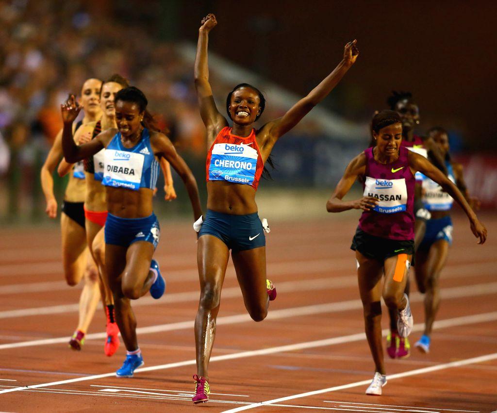 Mercy Cherono (C) from Kenya celebrates winning the Women's 3000m race at the Memorial Van Damme IAAF Diamond League international athletics meeting in Brussels, ..