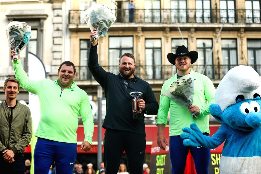 BRUSSELS, Sept. 6, 2019 - Tomas Walsh (2nd R) of New Zealand, Darlan Romani (2nd L) of Brazil and Ryan Crouser (1st R) of the United States stand on the podium after the men's shot put final of the ...