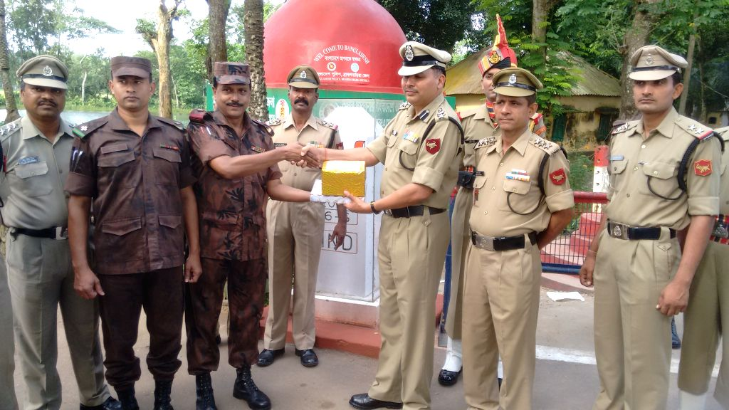 BSF and BGB officials exchange sweets on 69th Independence Day at Indo-Bangladesh border near Agartala, on Aug 15, 2015.