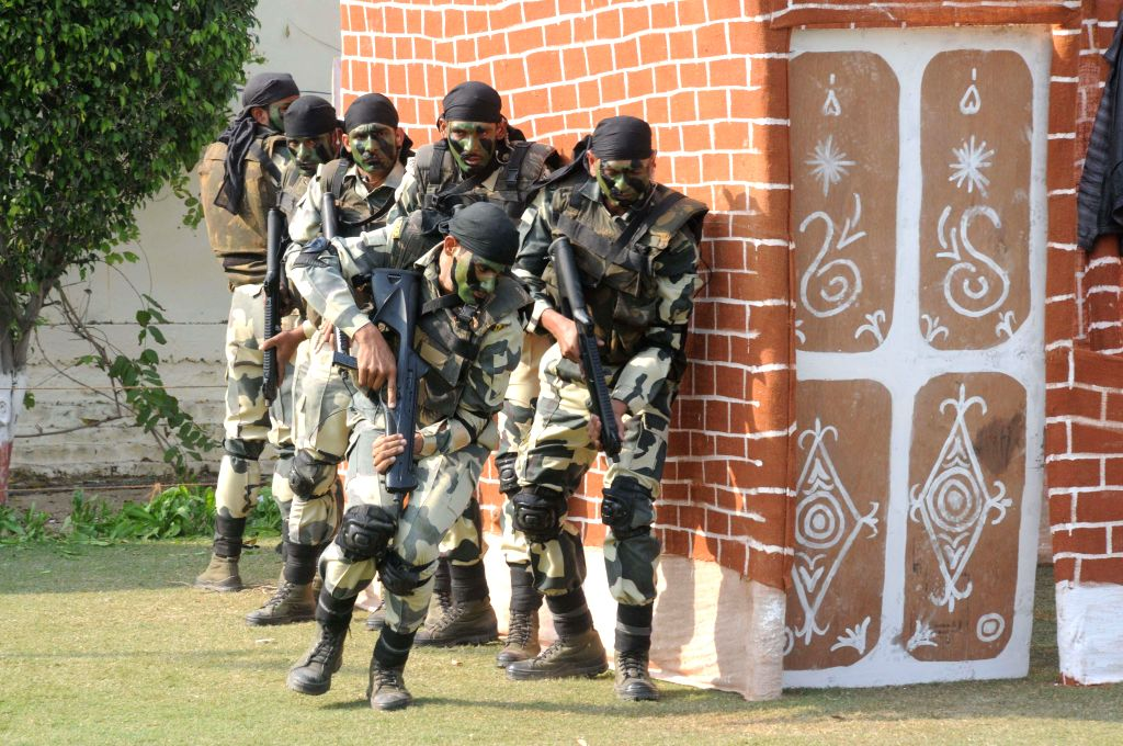 BSF commandos demonstrate their skills during a mock anti insurgency operation ahead of BSF Raising Day in New Delhi on Nov 26, 2014.