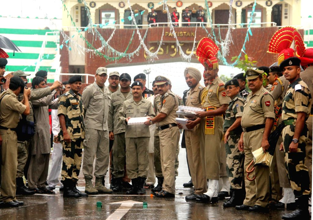 BSF DIG M F Farooqui greeting Pakistani Rangers wing Commander Adnan on the occasion of 67th Independence Day, at Attari-Wagah, international border onAugust 15, 2013. (Photo::: IANS)