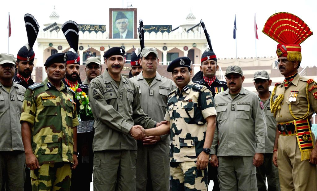 BSF DIG MF Farooqui shaking hand with his Pakistani counterpart at Zero line at Attari border on the occasion of Eid ul Fitr on July 29, 2014.