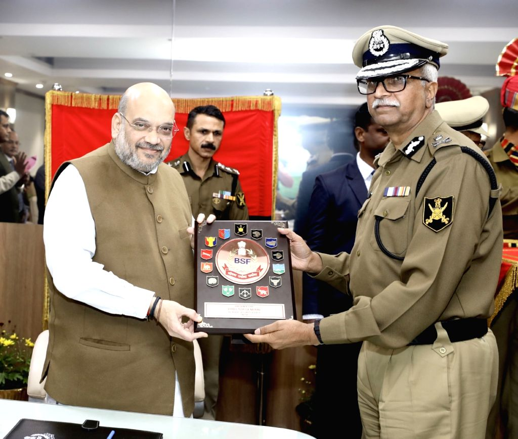 BSF Director General (DG) V K Johri presents a memento to Union Home Minister Amit Shah during his visit to the BSF Headquarters in New Delhi on Dec 13, 2019. - Amit Shah