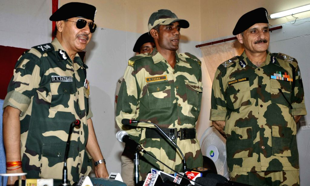 BSF jawan Satyasheel Yadav and senior BSF officials during a press conference in Jammu on Aug 8, 2014. Yadav was captured by Pakistani troops after he was swept away by the Chenab river to Pakistan, . - Satyasheel Yadav