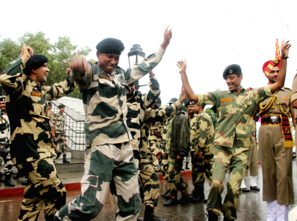 BSF officers and jawans dancing on the occasion of 67th Independence Day, at Attari-Wagah, international border on August 15, 2013. (Photo::: IANS)