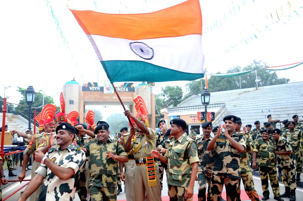BSF personnel cerebrate Independence Day at Indo-Pak border in Attari of Punjab on Aug 15, 2015.