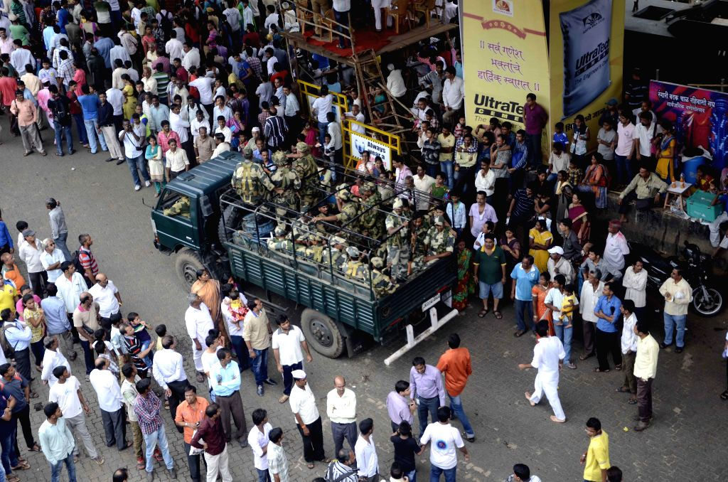 BSF personnel deployed during Ganesh idol immersion procession under in Mumbai on Sept 8, 2014.