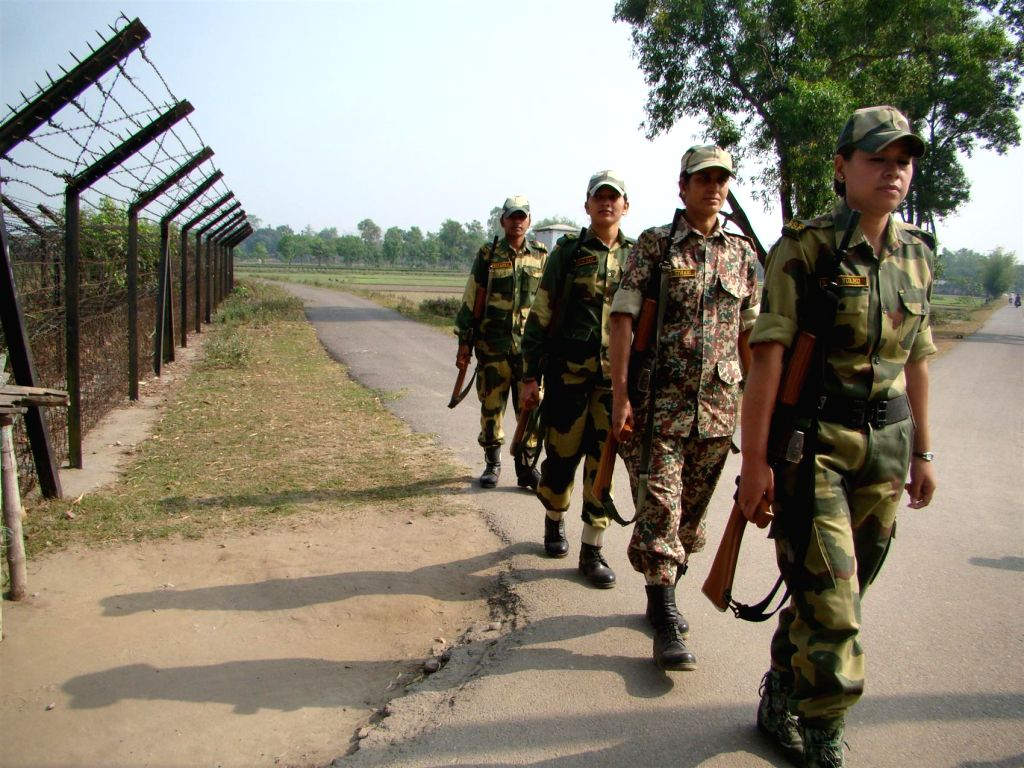 BSF personnel patrol near Indo-Bangladesh border in Jalpaiguri of West Bengal on April 17, 2014.