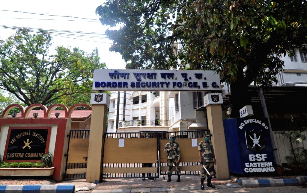 BSF personnel stand guard outside the Border Security Force Eastern Command Headquarters in Kolkata during the extended nationwide lockdown imposed to mitigate the spread of coronavirus; on ...