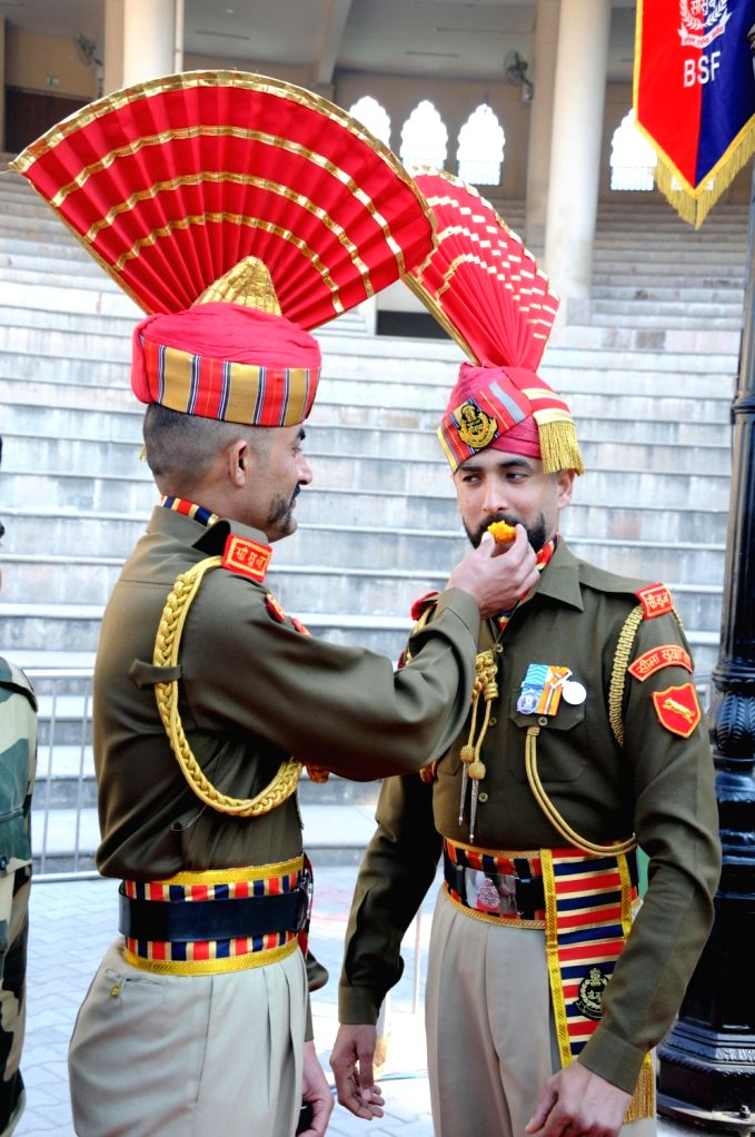 BSF soldiers exchange sweets during the 71st Republic Day celebrations at Indo-Pak border at Attari, near Amritsar on Jan 26, 2020.