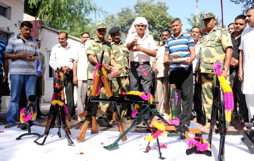 BSF soldiers perform 'Shastra Puja' on Vijaya Dashmi in Amritsar, on Oct 22, 2015.