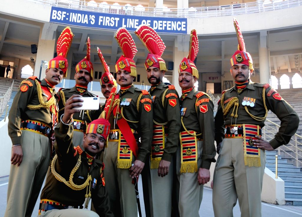 BSF soldiers pose for selfies during the 71st Republic Day celebrations at Indo-Pak border at Attari, near Amritsar on Jan 26, 2020.