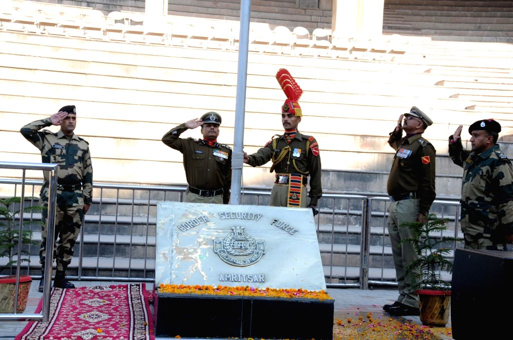 BSF soldiers salute the tricolor during the 71st Republic Day celebrations at Indo-Pak border at Attari, near Amritsar on Jan 26, 2020.