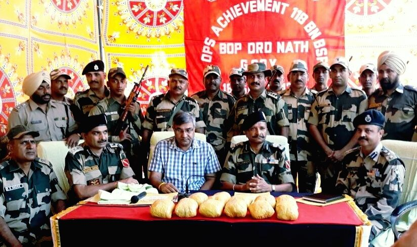 BSF troopers present before press 12 kg heroin seized from two locations near the India-Pakistan border in the Abohar sector of Fazilka, Punjab on Sept 18, 2017.