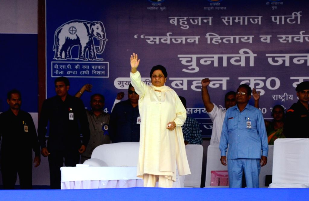 BSP supremo Mayawati waves at supporters during a public rally ahead of Maharashtra Assembly elections, in Nagpur on Oct 14, 2019.