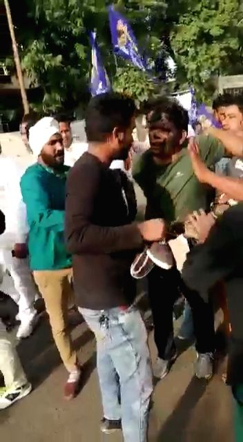 BSP workers blackened the face of Ram Gautam, party's national coordinator and Sita Ram Sila (state in charge) and paraded them on donkey putting garlands of shoes and slippers in their neck ...