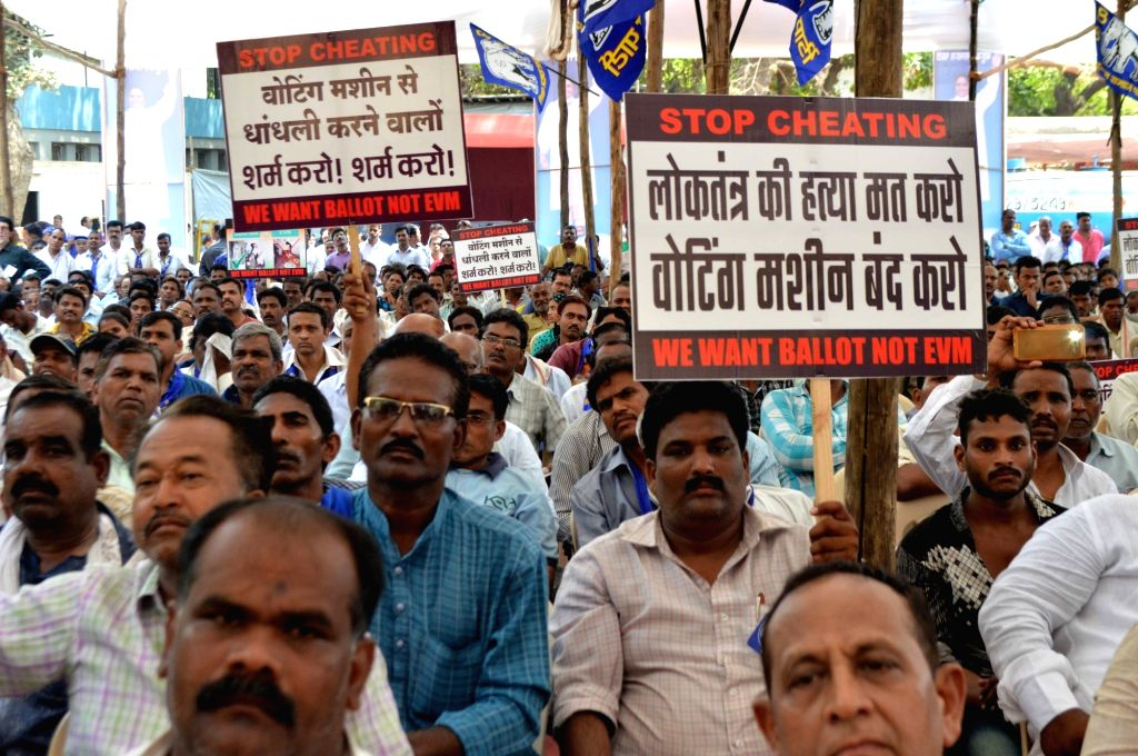 BSP workers stage a demonstration against usage of Electronic Voting Machines in elections at Azad Maidan in Mumbai, on April 11, 2017.