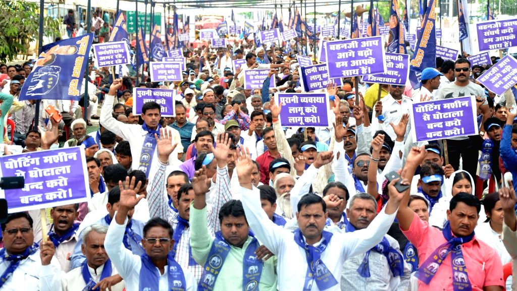 BSP workers stage a demonstration against usage of Electronic Voting Machines in elections in Bhopal on April 11, 2017.