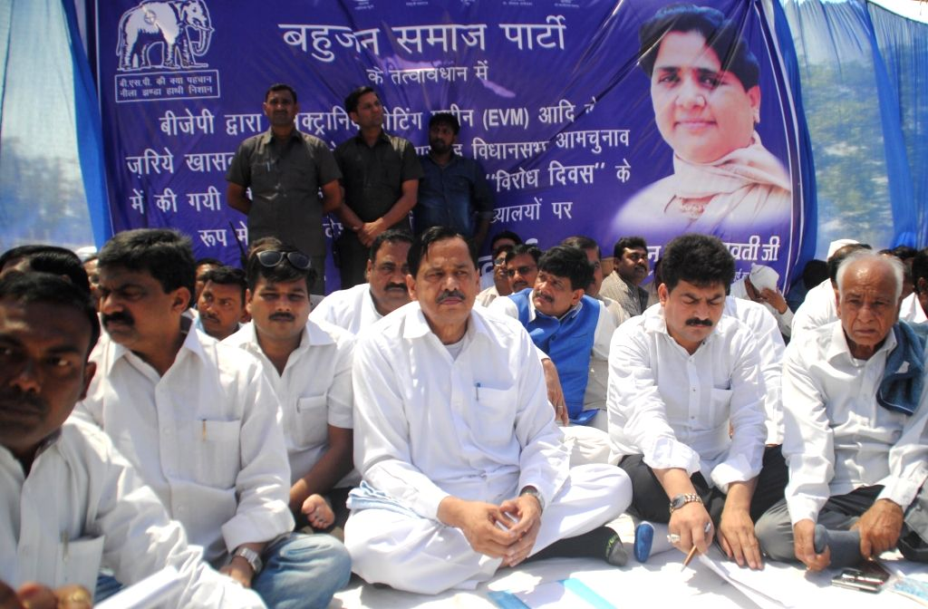 BSP workers stage a demonstration against usage of Electronic Voting Machines in elections in Lucknow on April 11, 2017.