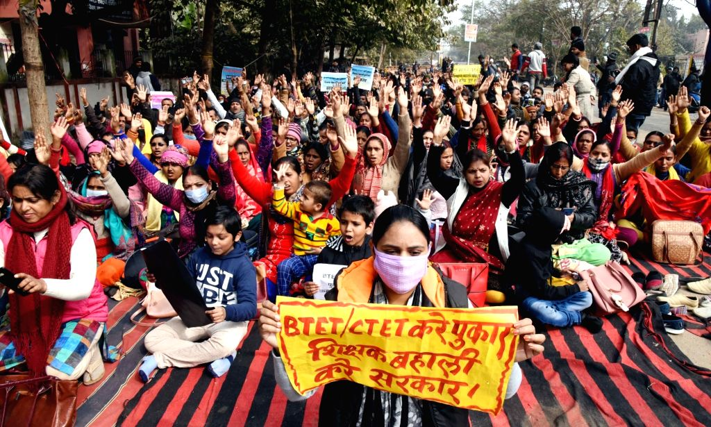 BTET & CTET teachers sit on a sit in with their children over their demands at Gardanibagh , Patna on 27 january 2021
