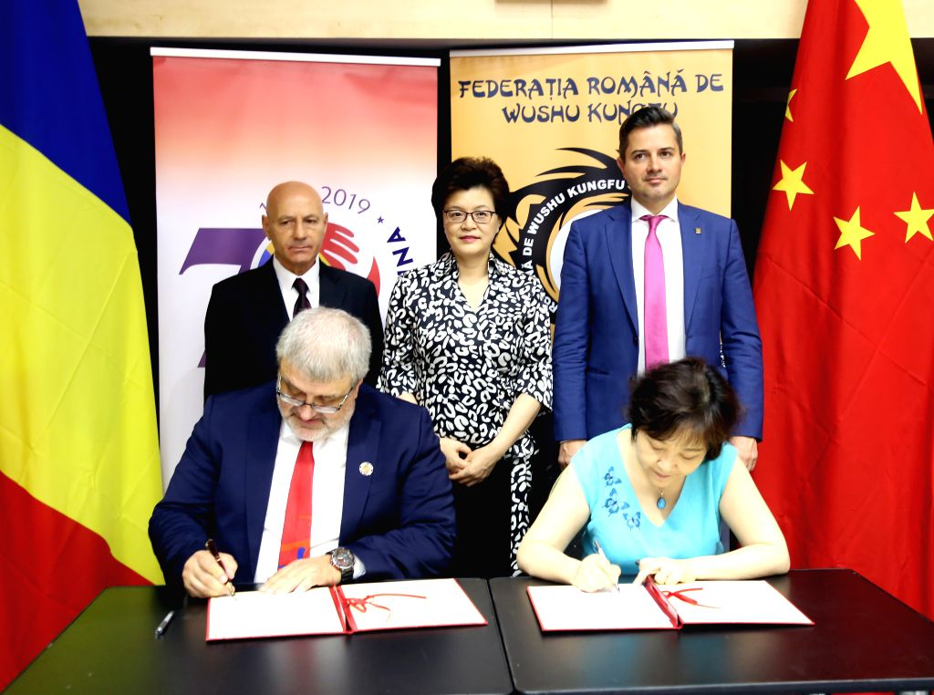 BUCHAREST, Aug. 10, 2019 - Jiang Yu (Rear C), Chinese Ambassador to Romania, Cosmin-Razvan Butuza (Rear R), State Secretary of the Romanian Ministry of Youth and Sports and Ion Benea (Rear L), ...