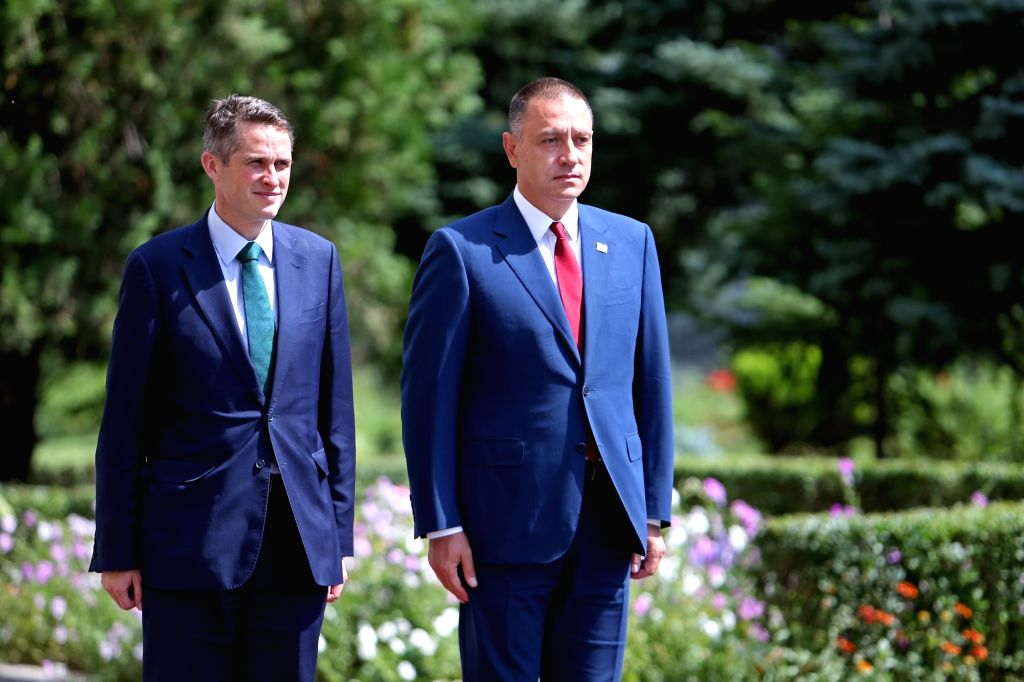 BUCHAREST, Aug. 2, 2018 - Romanian Defence Minister Mihai Fifor (R) welcomes British Secretary of State for Defence Gavin Williamson in Bucharest, capital of Romania, Aug. 2, 2018. - Mihai Fifor