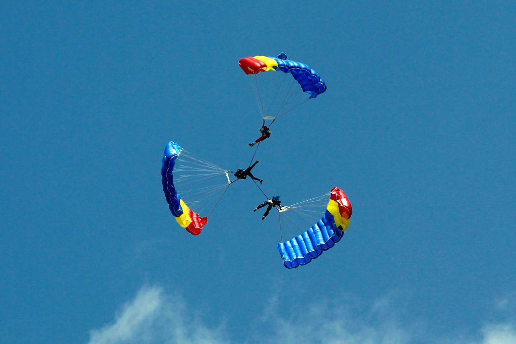 BUCHAREST, Aug. 24, 2019 - Romanian paratroopers of the Blue Wings perform during the Bucharest International Air Show in Bucharest, Romania, on Aug. 24, 2019. Bucharest International Air Show and ...