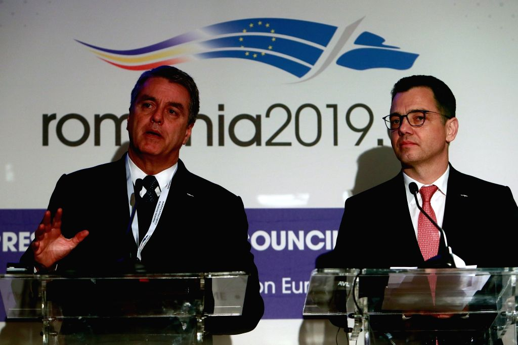 BUCHAREST, Feb. 21, 2019 - Director General of the World Trade Organization (WTO) Roberto Azevedo (L) and Stefan-Radu Oprea, Romania's Minister of Business Environment, Commerce and Entrepreneurship, ...
