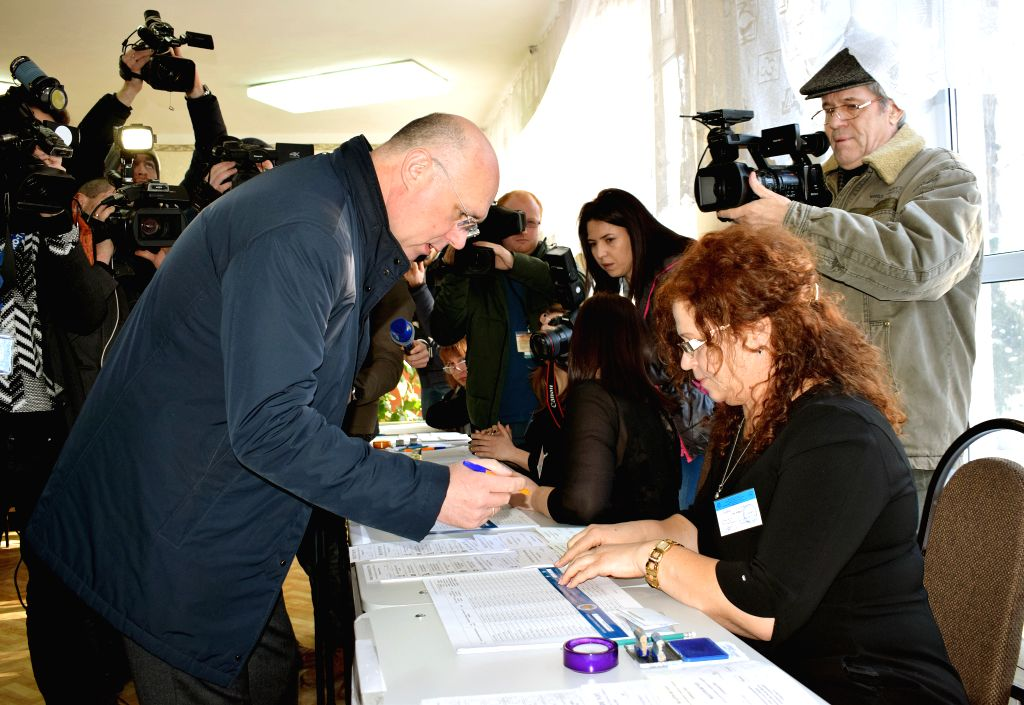 BUCHAREST, Feb. 24, 2019 - Moldovan Prime Minister Pavel Filip (L, front) registers before voting in parliamentary elections at a polling station in Chisinau, capital of Moldova on Feb. 24, 2019. ... - Pavel Filip