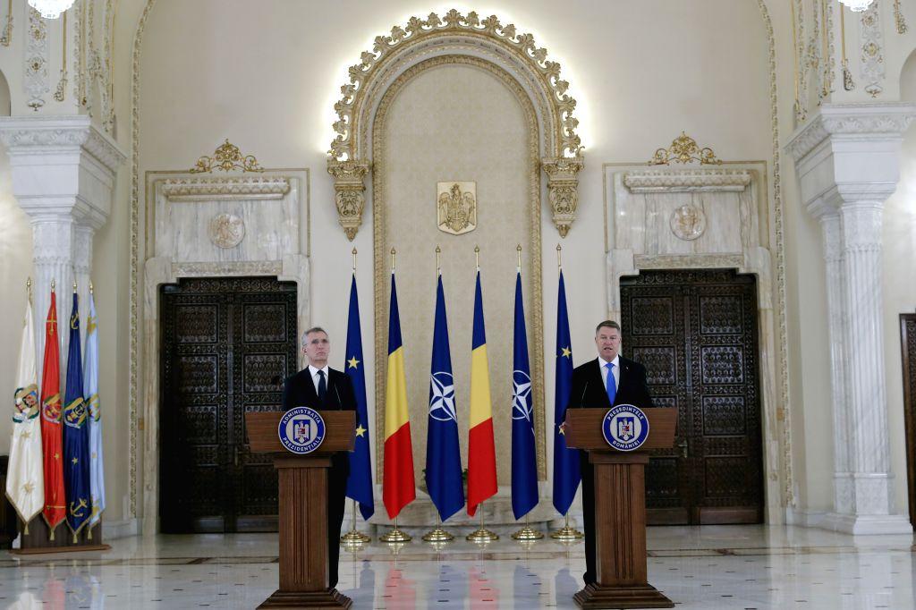 BUCHAREST, Jan. 31, 2019 - NATO Secretary General Jens Stoltenberg (L) and Romanian President Klaus Iohannis attend a news conference in Bucharest, Romania, Jan. 31, 2019. NATO stays the bedrock of ...