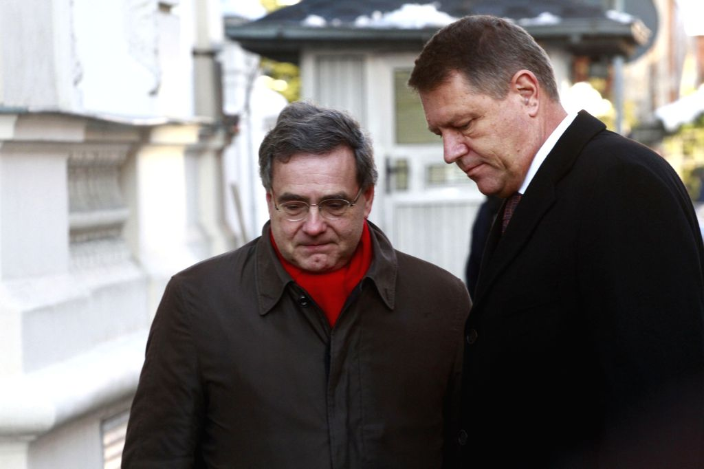 """Romanian President Klaus Iohannis, accompanied by the French ambassador, pays his condolence to the victims of the shooting at the office of """"Charlie ..."""