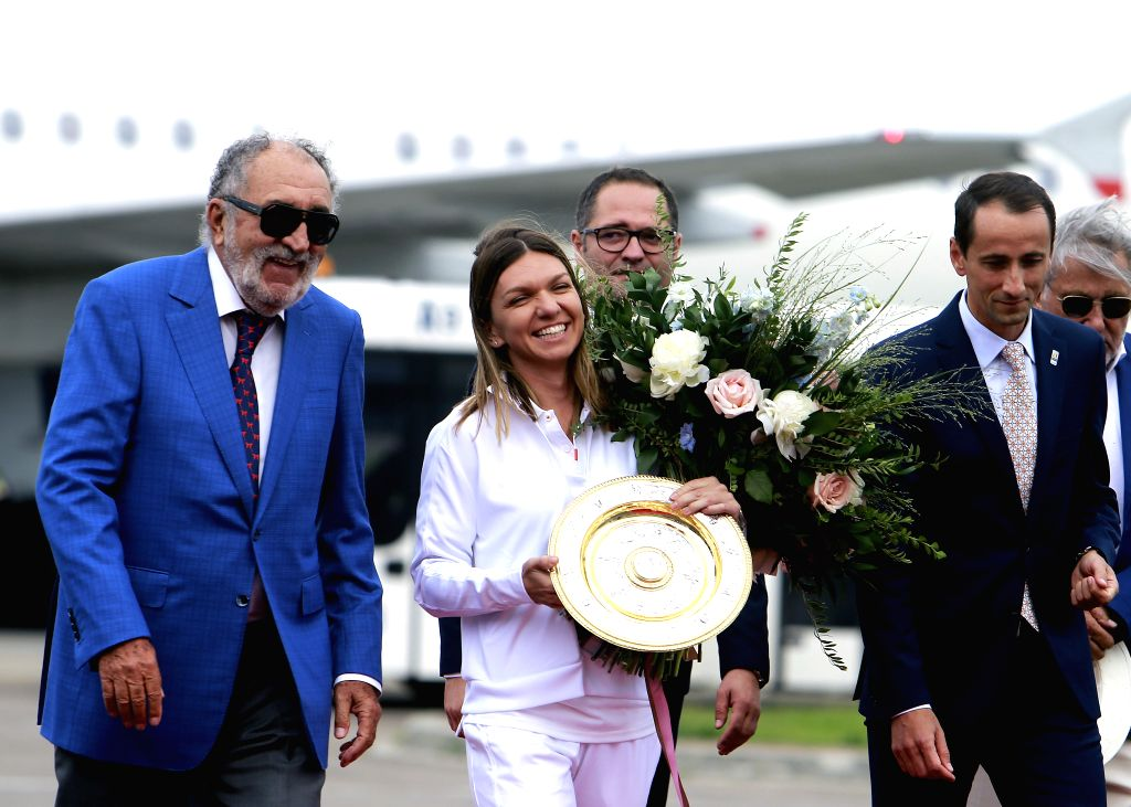 BUCHAREST, July 16, 2019 - Romanian tennis player Simona Halep (2nd L), 2019 Wimbledon Women's singles champion, arrives at the Henry Coanda International Airport in Bucharest, capital of Romania, ...
