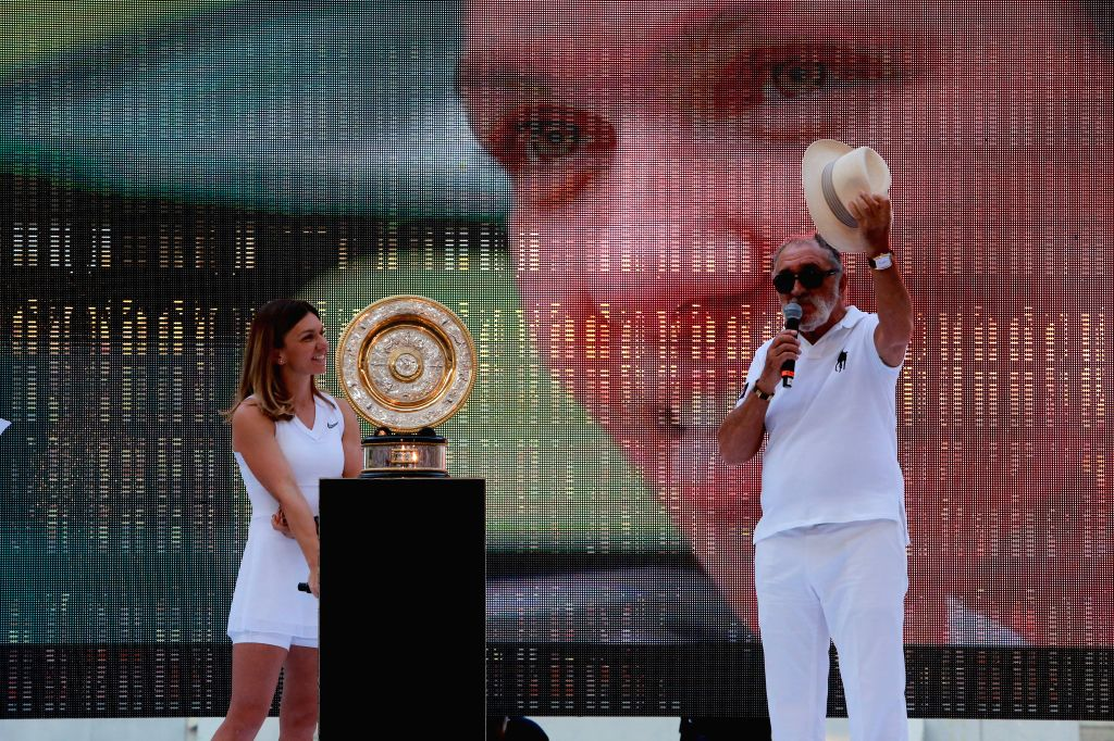 BUCHAREST, July 18, 2019 - Former tennis player Ion Tiriac (R) and Romanian tennis player Simona Halep, winner of the 2019 Wimbledon Tennis Championships, attend a special ceremony at the National ...