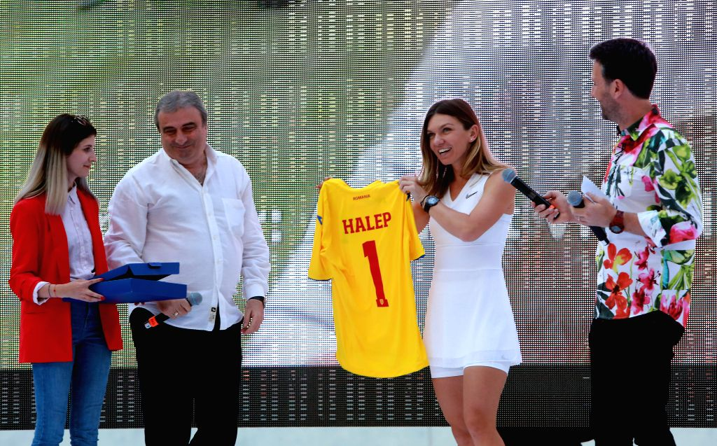 BUCHAREST, July 18, 2019 - Simona Halep(2nd R), winner of the 2019 Wimbledon Tennis Championships, receives a T-shirt with number 1 from Romanian Football Federation at a special ceremony at the ...