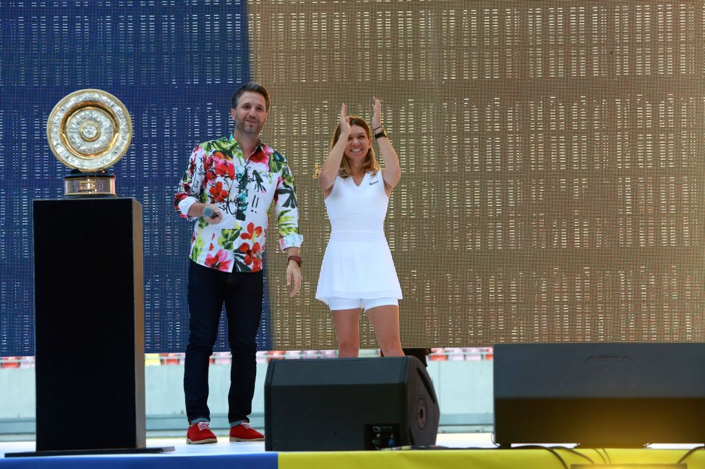 BUCHAREST, July 18, 2019 - Simona Halep (R), winner of the 2019 Wimbledon Tennis Championships, greets fans at a special ceremony at the National Arena stadium in Bucharest, Romania, July 17, 2019.