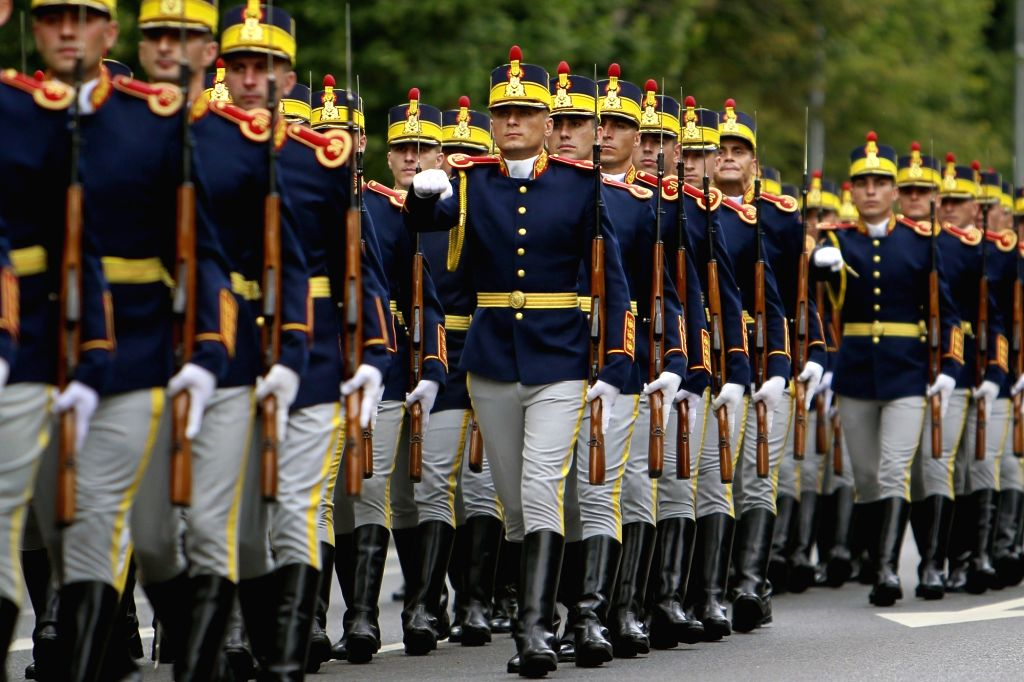 BUCHAREST, July 20, 2018 - Soldiers march during a ceremony marking Romania's Aviation Day at the Monument of Aviation Heroes in Bucharest, capital of Romania, July 20, 2018.
