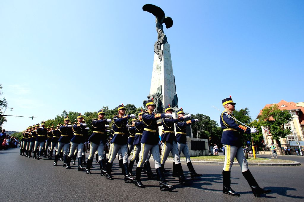 BUCHAREST, July 20, 2019 - Soldiers march past the Statue of Air Heroes, built to honour Romania's military aviation heroes, during Aviation Day celebrations in Bucharest, capital of Romania, July ...