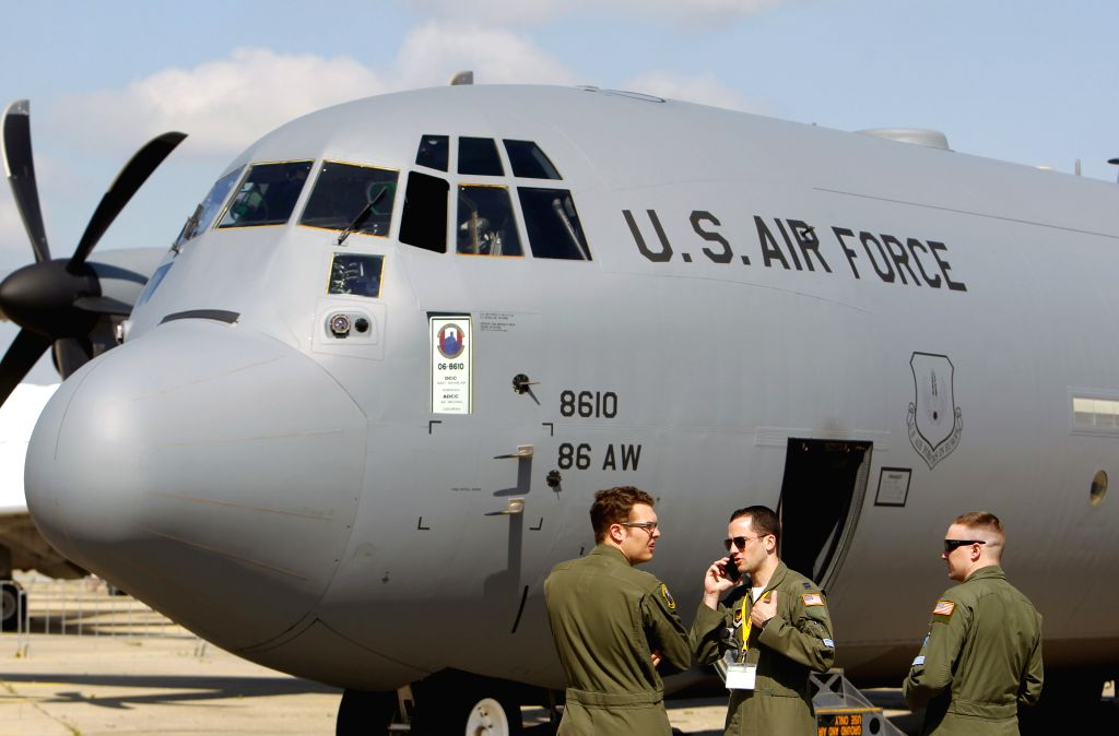 BUCHAREST, May 18, 2016 - U.S. soldiers talk in front of a U.S. C-130 Hercules military airplane during Black Sea Defense & Aerospace (BSDA) exhibition in Bucharest, capital of Romania, on May ...