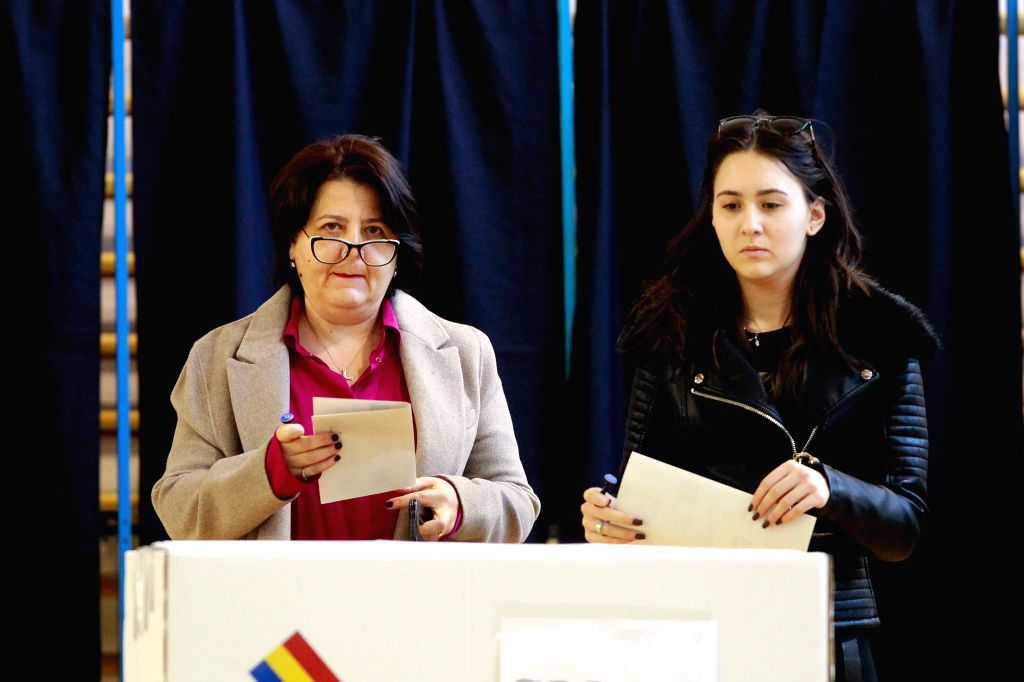 BUCHAREST, Nov. 10, 2019 - People vote at a polling station in Bucharest, Romania, Nov. 10, 2019. Romanian voters went to the polls on Sunday to elect a new president out of 14 candidates. Polling ...