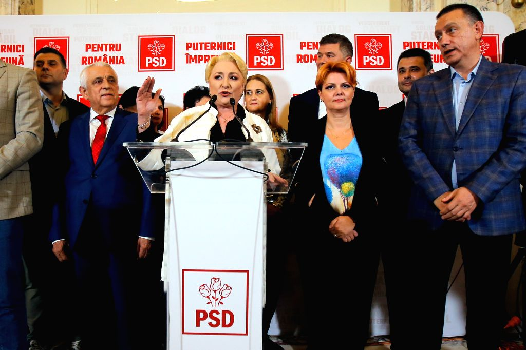 BUCHAREST, Nov. 10, 2019 - Romania's former Prime Minister and presidential candidate Viorica Dancila (C) speaks to the media in Bucharest, Romania, on Nov. 10, 2019. Exit polls showed that incumbent ...