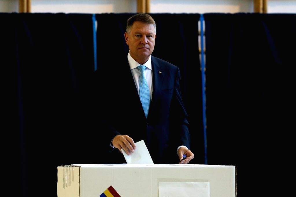 BUCHAREST, Nov. 10, 2019 - Romanian President Klaus Iohannis casts his ballot at a polling station in Bucharest, Romania, Nov. 10, 2019. Romanian voters went to the polls on Sunday to elect a new ...