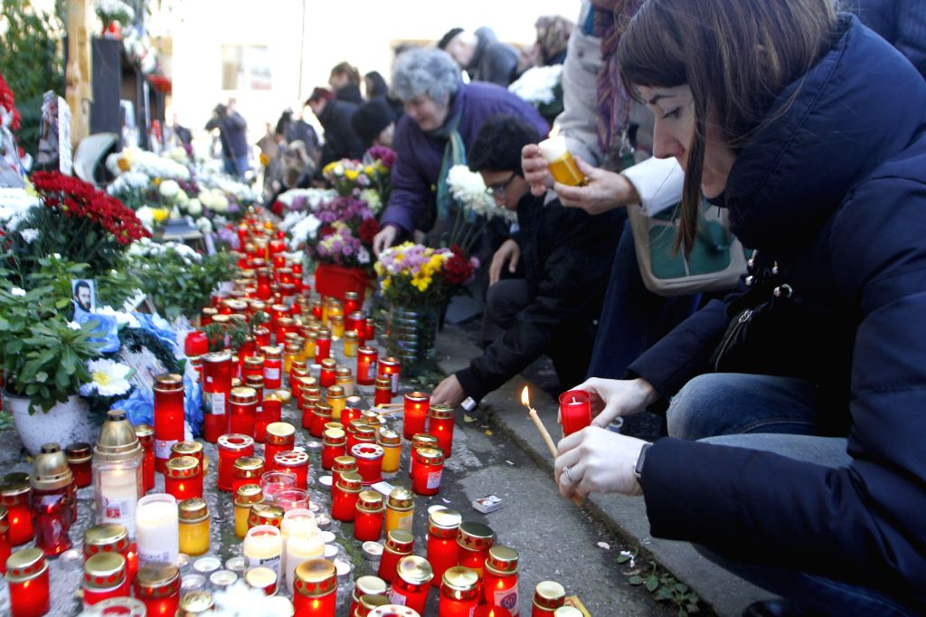 BUCHAREST, Oct. 31, 2016 - People commemorate the victims of the Colectiv nightclub fire that killed 64 people one year ago, in Bucharest, Romania, Oct. 30, 2016.