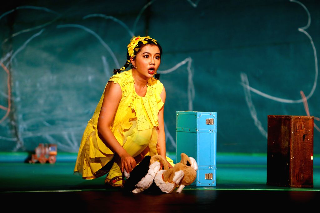 """BUCHAREST, Sept. 14, 2019 - Tang Yan of China National Theatre for Children performs in """"TR-E-E"""" show, a story of a young ginkgo tree, during the 15th ImPuls International Festival of ..."""