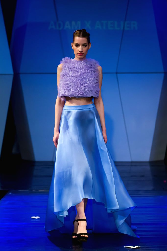 A model presents a creation by British designer Adam X Atelier during the Budapest Fashion Week in Budapest, Hungary on Nov. 26, 2014. )