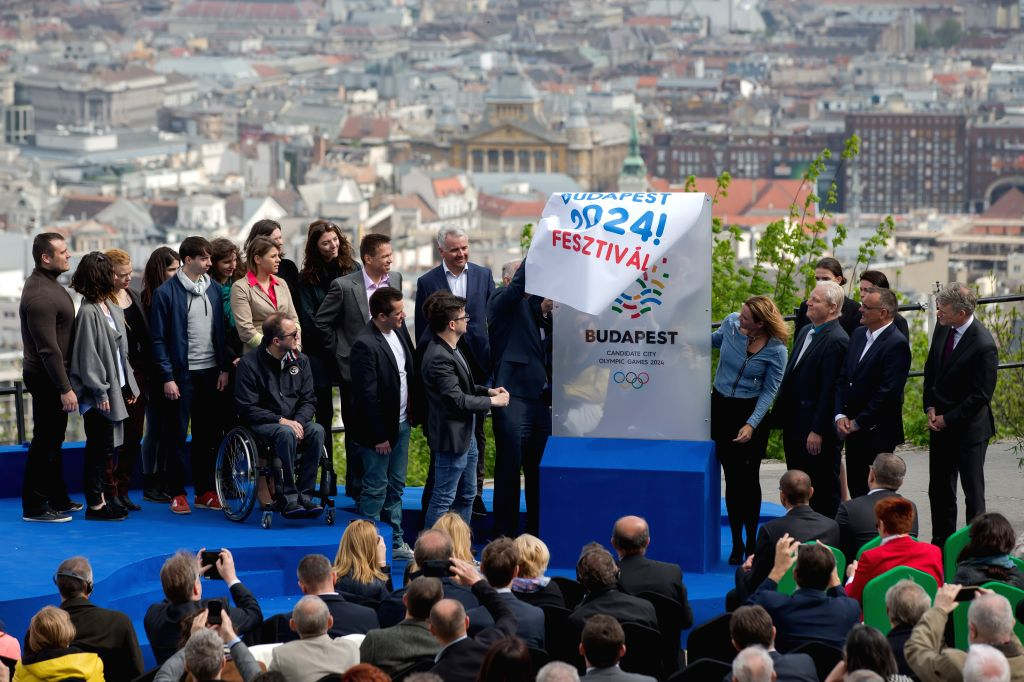 BUDAPEST, April 14, 2016 - Guests unveil the logo which Hungary plans to use in its bid for the 2024 Olympic and Paralympic Games, during the unveiling ceremony on the top of Gellert Hill in ...