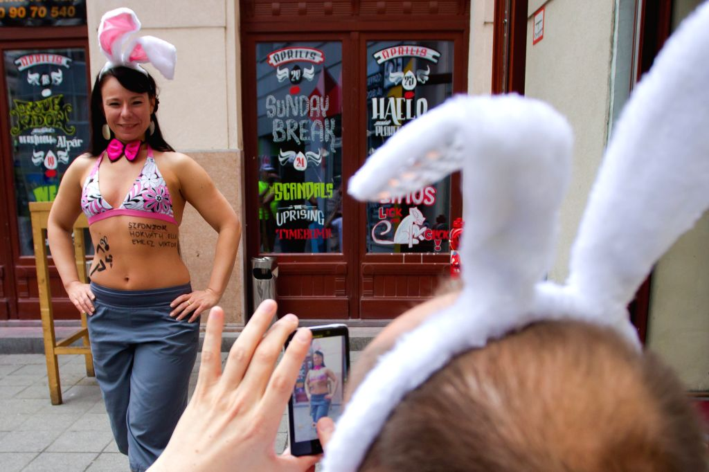 """A participant poses for photo during the first half naked """"Bunny run"""" to support a charity in Budapest, Hungary, on April 21, 2014. The participants ..."""