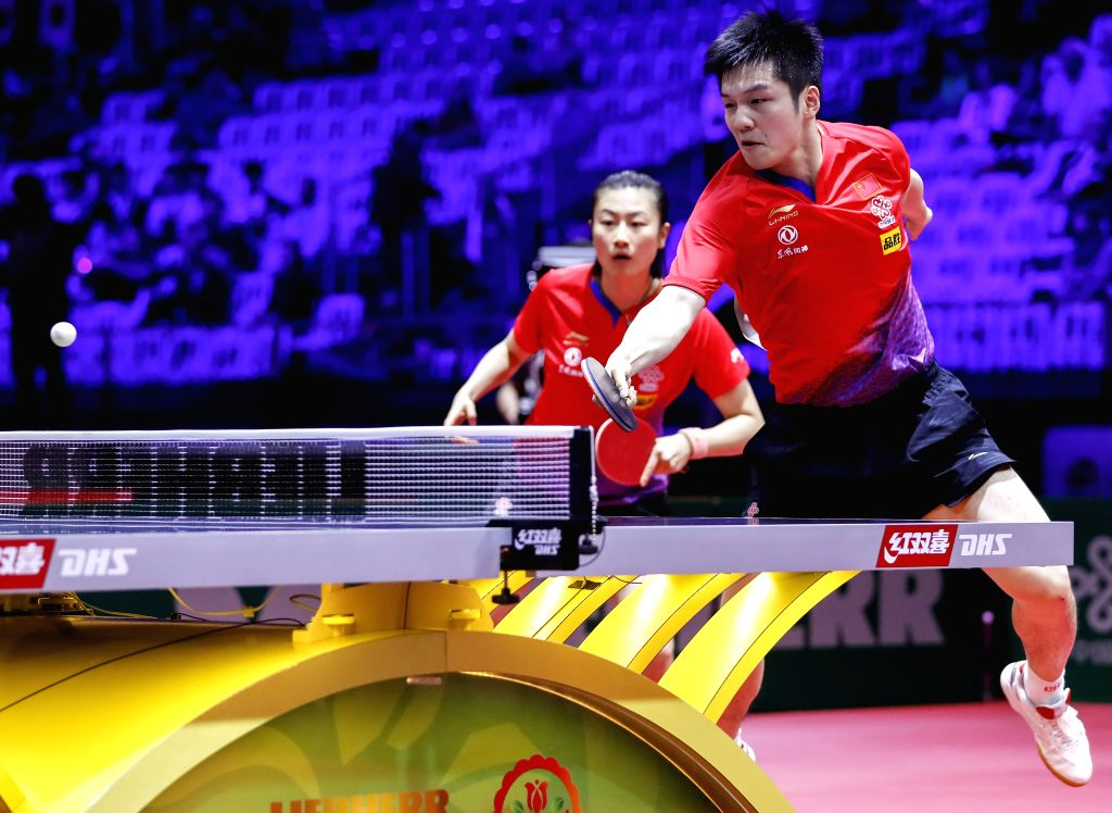 BUDAPEST, April 24, 2019 - Fan Zhendong (R) /Ding Ning of China compete during the mixed doubles round of 16 match with Tristan Flore/Laura Gasnier of France at 2019 ITTF World Table Tennis ...
